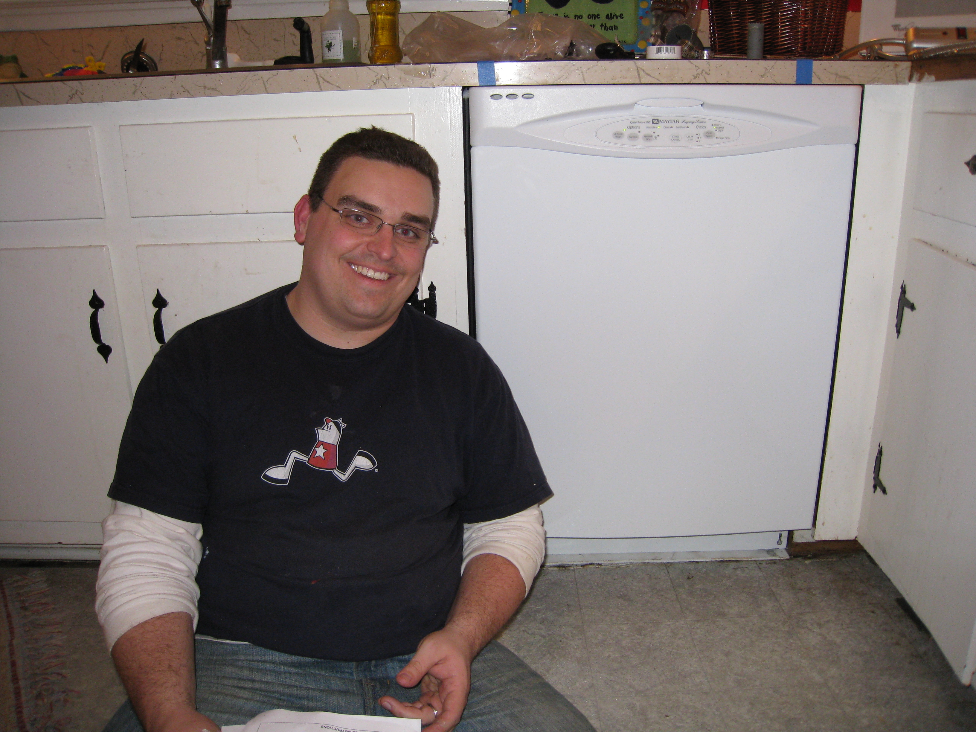 My husband looks amazing in this picture, but look next to him and check out my new dishwasher!!